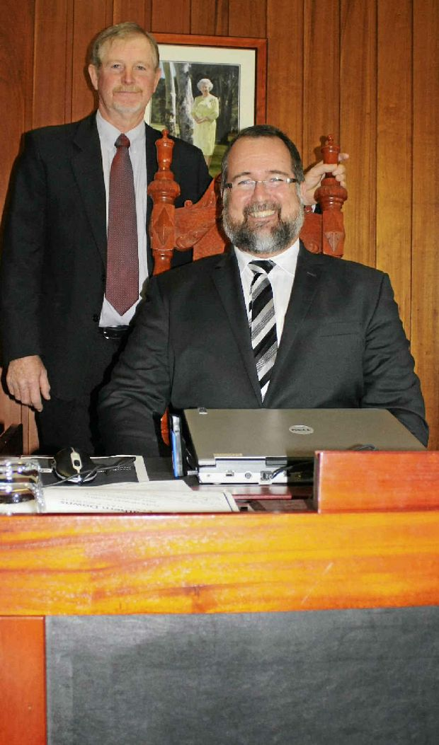 Southern Downs new mayor Peter Blundell seated in council chambers with deputy Ross Bartley.