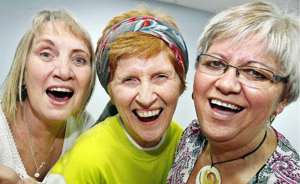 Laughter yoga teacher Lyn Burrows (centre) instructs Kathryn Lane and Margaret Baxter during a workshop.