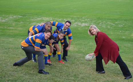 PLAY BALL: Logan Mayor Pam Parker, councillors Darren Power and Phil Pidgeon with players from the Logan City Rugby Union Club.