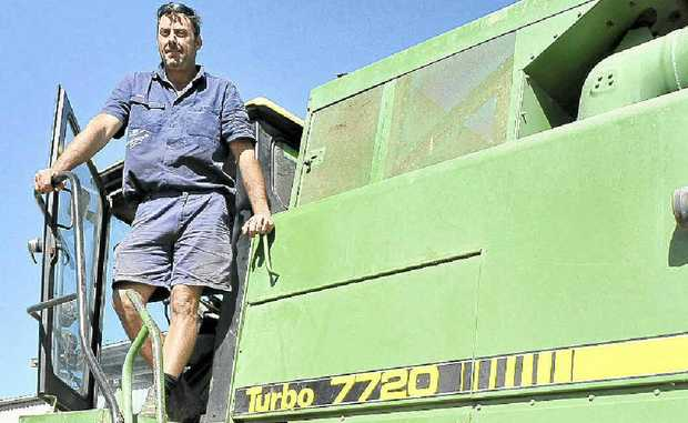 Rice-harvesting operator Allan Anderson at the 75-hectare OzRice farm at Woodburn.