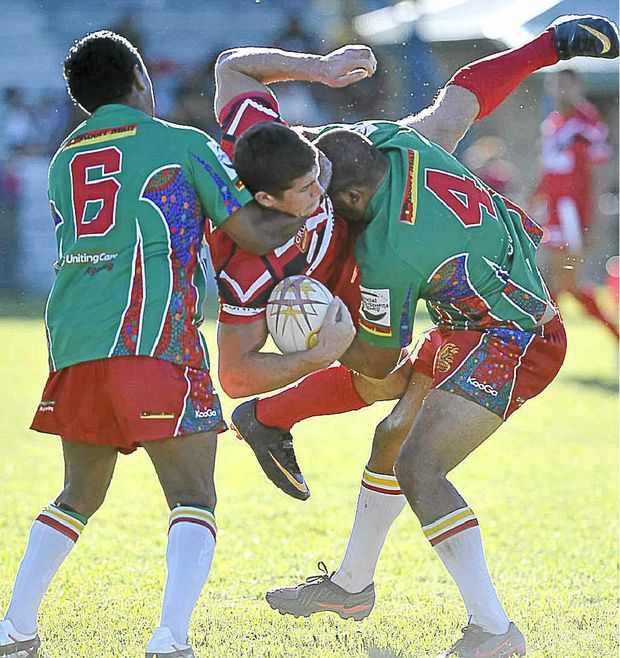 Northern United's Dan Randall (No.4) stops Cale Rowston of Byron Bay in United's 26-21 loss at Crozier Field, Lismore.