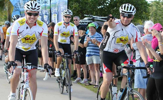 """HITTING THE ROAD: V8Supercar drivers James Courtney and Jonathon Webb and Sunrise sports presenter Mark Beretta led a peleton of riders in the """"Tour de Cure"""" on its departure from Airlie Beach.  Sharon Smallwood / Whitsunday Times"""