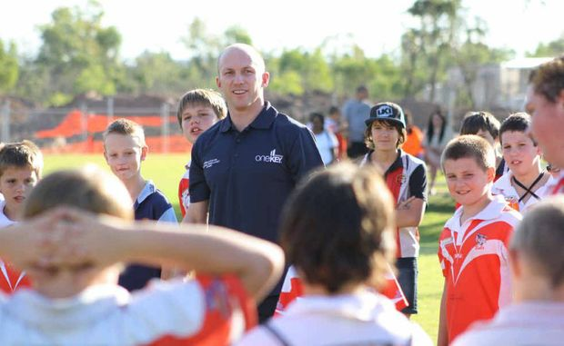 Darren Lockyer is swamped by junior fans during a visit to Dysart last week.