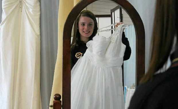 Caledonian debutante 16-year-old Demi Quirk takes a moment at Glamourous Brides to be sure she has chosen the right dress for her big night.