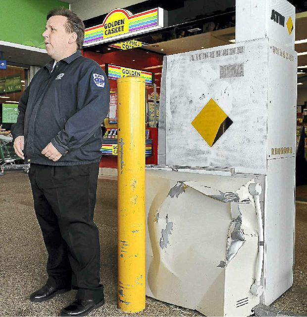 RPO Security officer Justin Tainton stands watch near an ATM that was targeted by thieves in the Bargara Central complex.