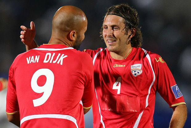 Sergio van Dijk (back) of Adelaide celebrates the first goal with team-mate Jonathan McKain during the AFC Champions League Group E match between Gamba Osaka and Adelaide United at Expo '70 Stadium on May 16, 2012 in Osaka, Japan.