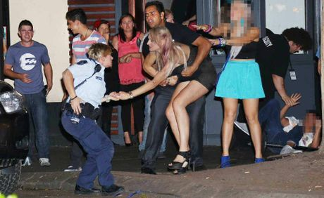 Simone Hermann and Constable Corrine Thackray in an altercation in the City Heart.