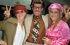 Lisa and Craig Frattini and Dee Stevens get their mojo on at the '60s themed fundraiser.