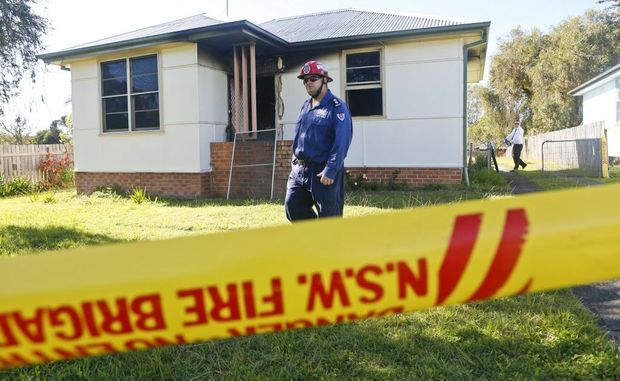 Fire Rescue NSW Grafton Station office Michael Kearns walks out the front of a property where a woman was killed in a house fire.