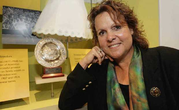Tennis champion Evonne Goolagong-Cawley poses with her Wimbledon trophies at the National Museum of Australia in Canberra.