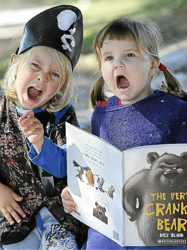 Jye Lynch, 3, and Olivia Thompson, 4, from Brewster Street Preschool practice their best growls in preparation for tomorrow's National Simultaneous Storytime.
