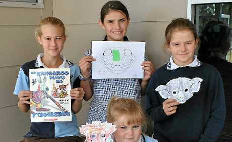 Making Australian animal masks inspired by the book they read are (back from left) Julia Walker, Ashleigh Browne, Kyarnee King-Taylor and (front) Micheala Harrington.