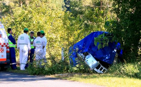 Emergency services investigate the scene of a crash that claimed the life of a 20-year-old man and left two teens injured.