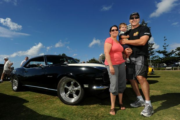 Sandra, Jaxen and Phil Teissl with a 1968 RSSS black coupe Chev Camaro in Queen Elizabeth park on Sunday.