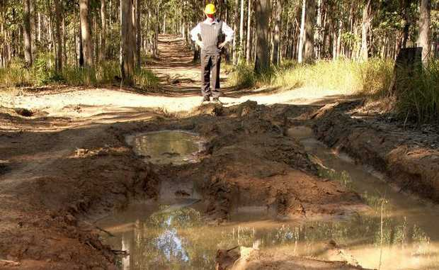 Forests NSW Community Forester David Wilson and one of the ruined road in the Bom Bom State Forest.