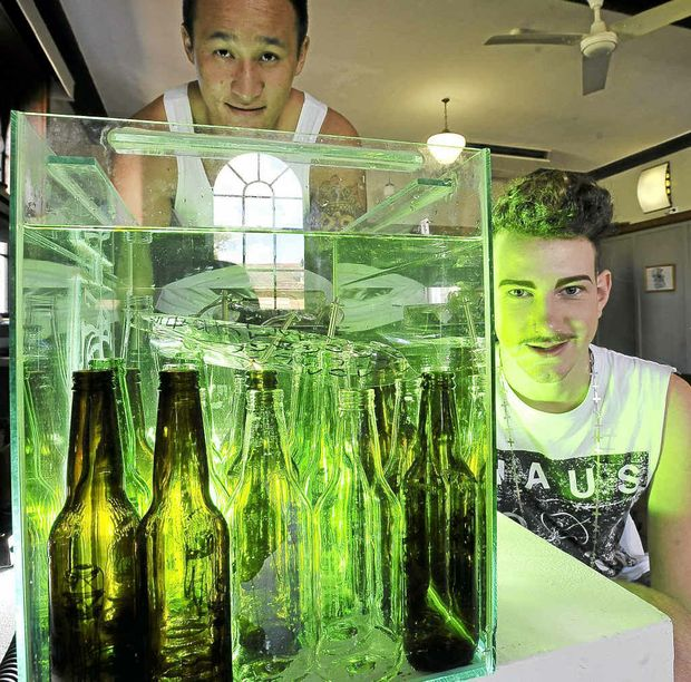 Southern Cross University students Paul Tran, left, and Ben Avery with Ben's artwork, Toxic.