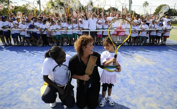Coach Talina Tipungwuti, tennis legend Evonne Goolagong and Sereni Goro-Rawson, 5 of Copmanhurst get together with hundreds of kids from the area for a indigenous tennis coaching day at the Grafton courts. Photo Adam Hourigan / The Daily Examiner