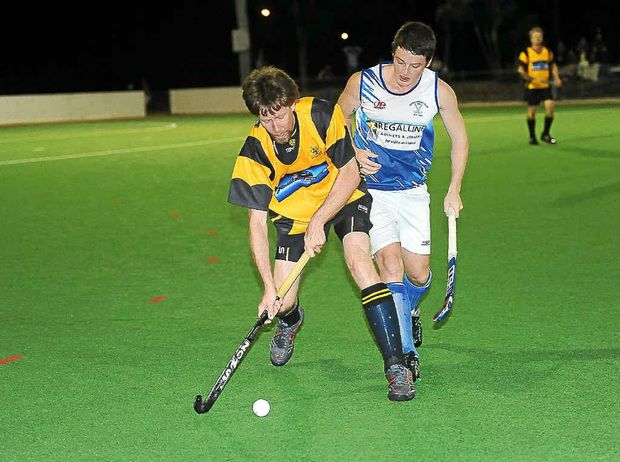 Rovers' Dean Wightman protects the ball against an attack from Cities' Josh Stacey in last year's Bundaberg Division 1 men's grand final.