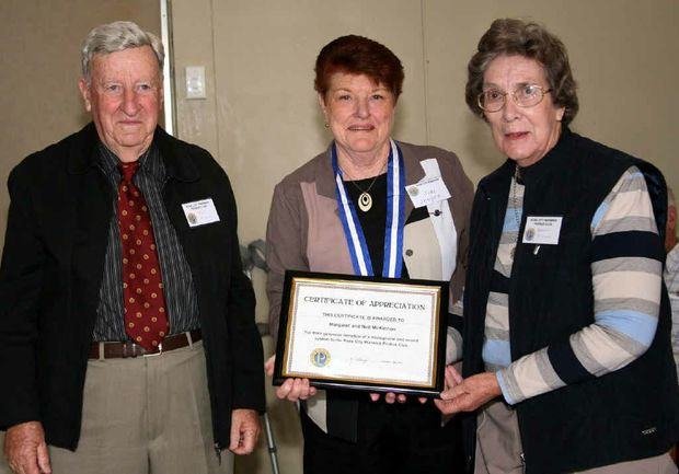 Probus president June Sawyer (middle) with Neil and Margaret McKinnon.