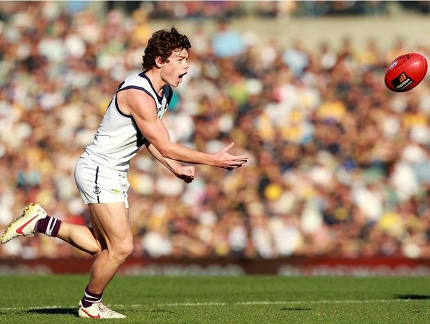 Lachie Neale of the Dockers handballs during the round nine AFL match between the West Coast Eagles and the Fremantle Dockers at Patersons Stadium on May 27, 2012 in Perth, Australia.