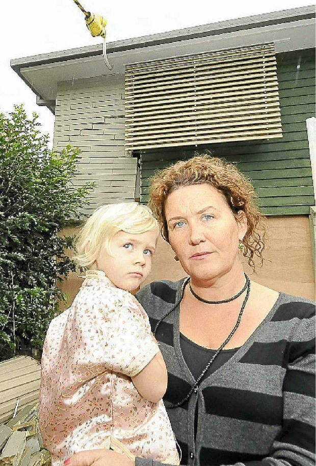 SLOW DOWN: Patricia Lockrey and her daughter Florence, 3, can no longer live in their Links Ave, East Ballina home after a car crashed into it, directly under Florence's bedroom.