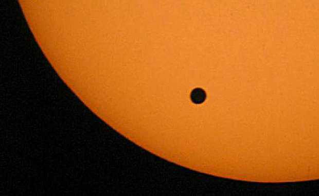Venus will appear as a small black dot travelling over the lower half of the sun during the transit, as it did in this photo taken in 2004.