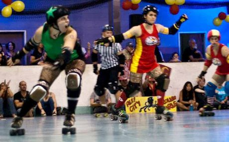 Tiffany Folmeg (left) competes as 'Ho Canada' with the Mackay City Roller Maidens during a bout against Cairns.