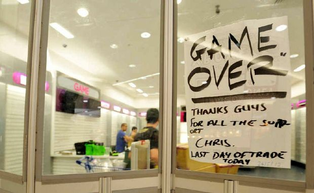 Staff from the Grafton GAME store in Shoppingworld packed-up after the shop was one of 60 around the country to be closed.