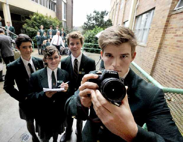 Woodlawn students, from left, Shay Langley, Amanda Griffin, Callum Riordan and Alex Mackney take school photos as part of the SNAZZI unit.