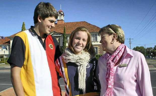 Exchange student Mathilde Scholzen (middle) with host family members Ben and Jill Mitchell.