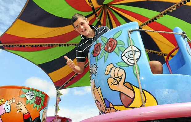 Marcus Waller warms up the teacups ahead of gates opening at the annual Bundaberg Show today.
