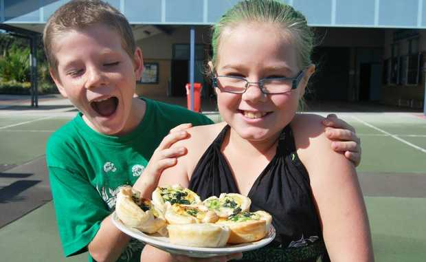 Tyrone Lambert and Zoey O'Connor tuck in to the green cuisine at Bogangar Public School's Green day.