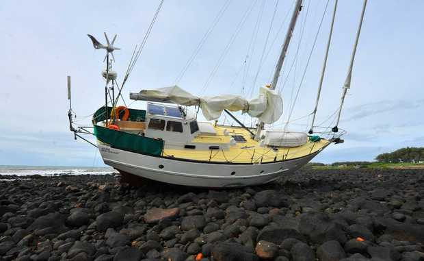 The yacht Stargull which ran aground on the rocks at Burnett Heads. Photo: Scottie Simmonds / NewsMail