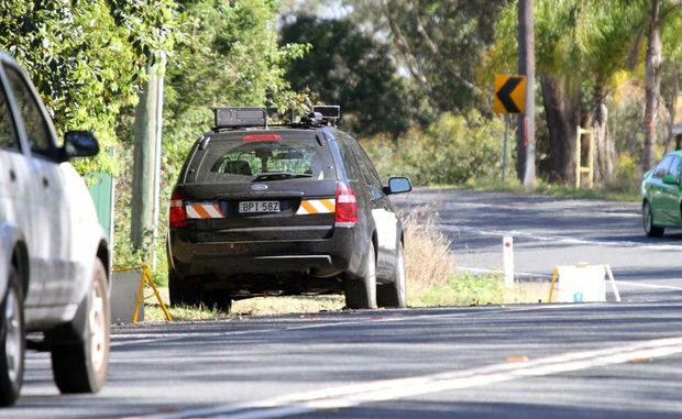 An angry motorist proved a nuisance to the operator of this mobile speed camera near Corindi. Photo: Frank Redward.