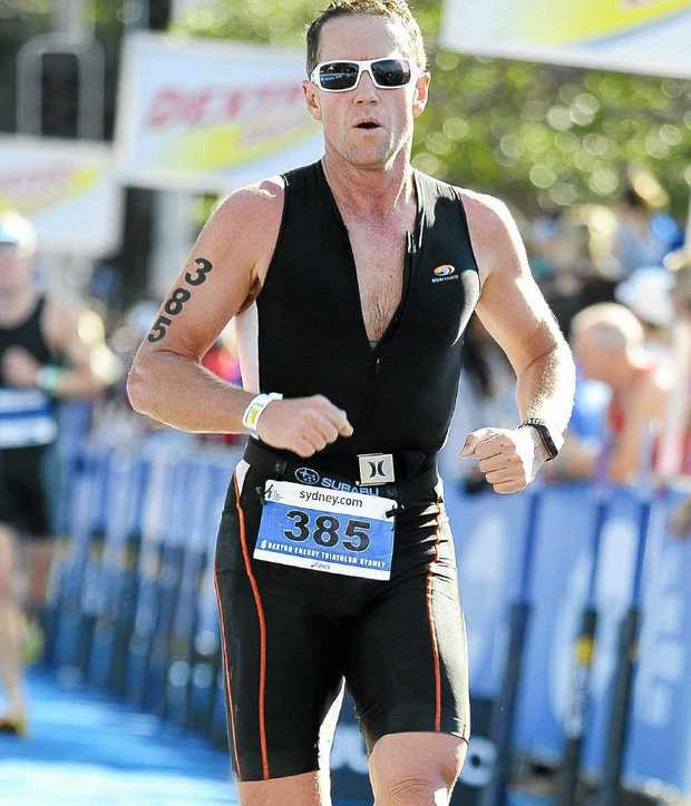 Grafton solicitor Greg Coombes will be trying to better last year's time when he competes this weekend in the Ironman Cairns triathlon. Photo: Contributed