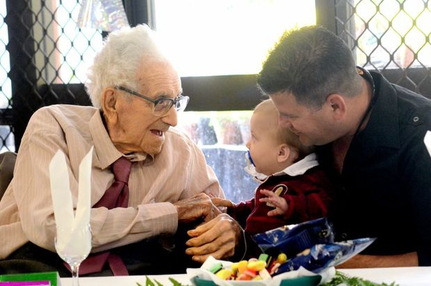 Birthday boy Jack Glasson swaps tales with great-grandson Cory and grandson Robin Catling.