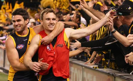 Chris Newman and Nathan Foley of the Tigers celebrate after the Tigers defeated