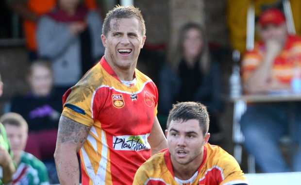 Rookie hooker James Sanders fires out a classic pass in today's Coffs Harbour win against Macksville to the approval of veteran Darren Blackett.