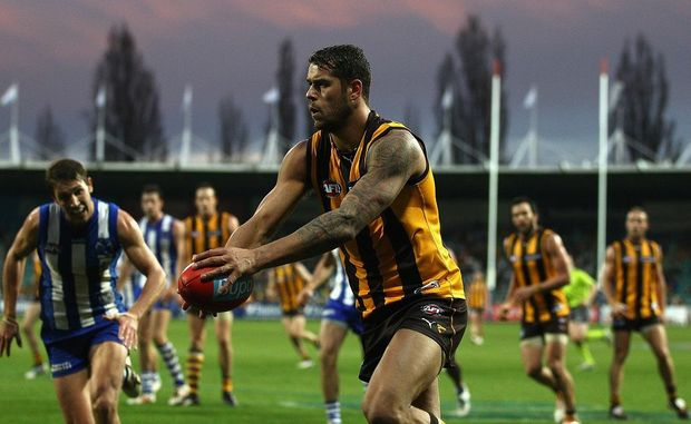 Lance Franklin of the Hawks kicks during the round 10 AFL match between the Hawthorn Hawks and the North Melbourne Kangaroos at Aurora Stadium