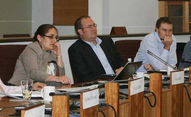 Insurance representatives listen on at the Central Highlands flood mitigation presentation.