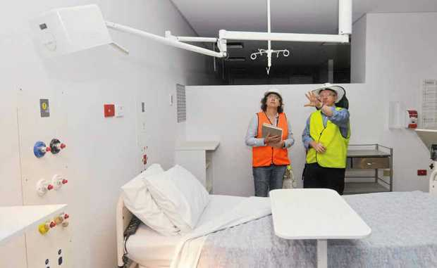 Mackay Queensland Health public affairs manager Danielle Jesser and redevelopment team co-ordinator Glenn Hokin inspect the new adult emergency department.