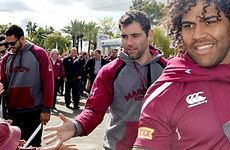 Greg Inglis (left), Cameron Smith and Sam Thaiday shake hands with fans in Roma.