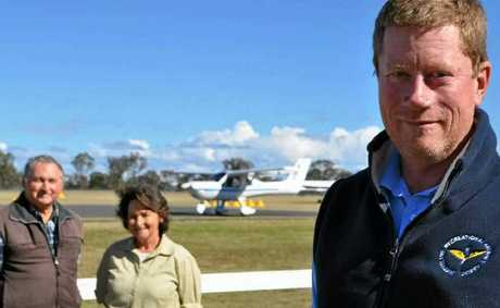 Queensland Recreation Aircraft Association president Kelvin Hutchinson (front) with life members Bill and Val Wilkinson.