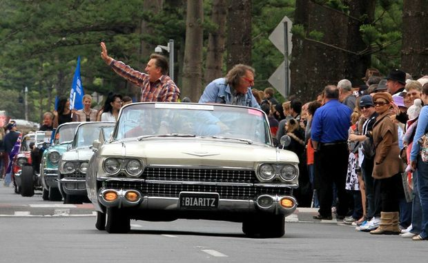 Frankie J Holden and Wilbur Wilde enjoying the street parade in an old Chevy convertible.