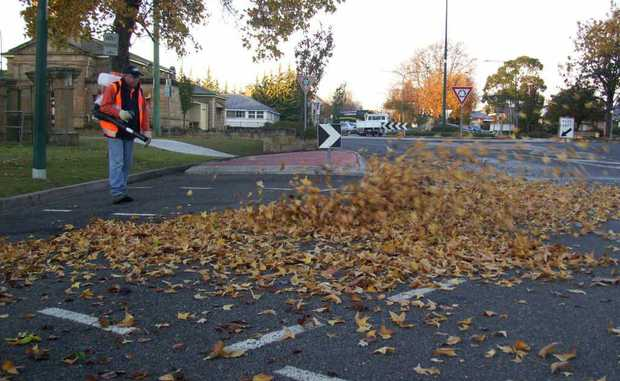 Council workers clean up the last of autumn leaves.