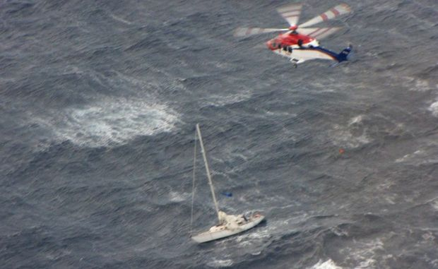 TWO people were rescued in wild weather from a sinking yacht approximately 50 nautical miles off the coast of Byron Bay early this morning.