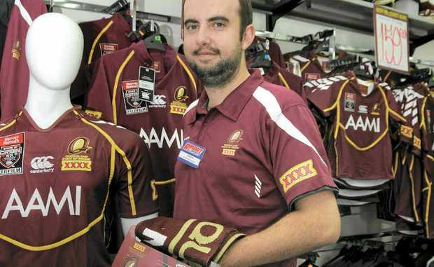 Jason Volp, manager of Amart All Sports Toowoomba, is kept busy selling State of Origin merchandise.
