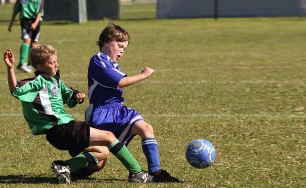 Grafton City Blades player Cooper Stockwell takes on Maclean Black player Malakye O'Sullivan in a game earlier this year.