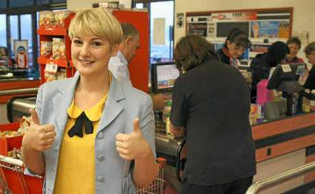 It's not often you get six checkout clerks to swipe through your groceries at once, but after Nicki Stacey zoomed through the Supa IGA Warwick aisles, racking up $647.45 worth of groceries in three minutes, it was all hands on deck.