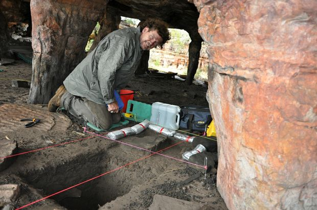University of Southern Queensland archeologist Professor Bryce Barker works on a Northern Territory site where he and fellow team members uncovered ancient Aboriginal rock art.